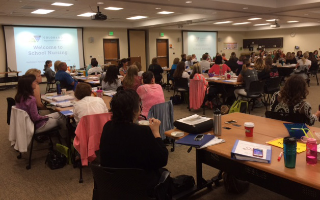 Nurses attend orientation in a conference room in Cherry Creek.