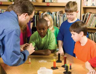 Photo of teacher and kids doing a science experiment